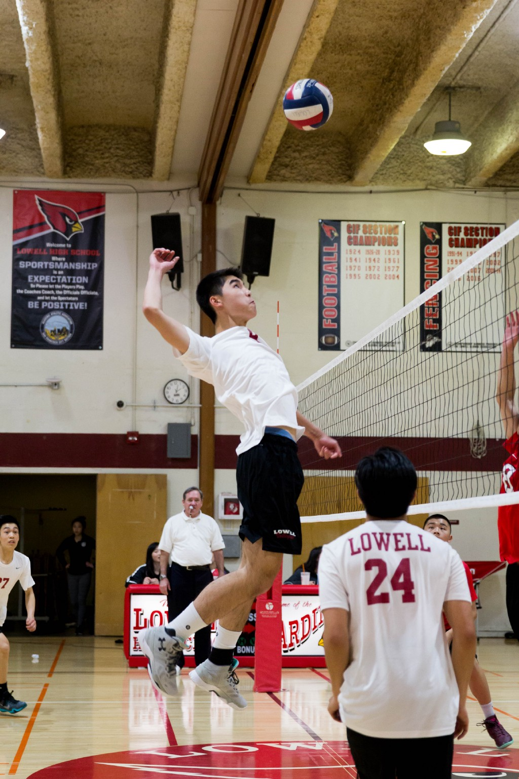 Senior middle blocker Alan Duong spikes the ball against the Washington Eagles on April 5.