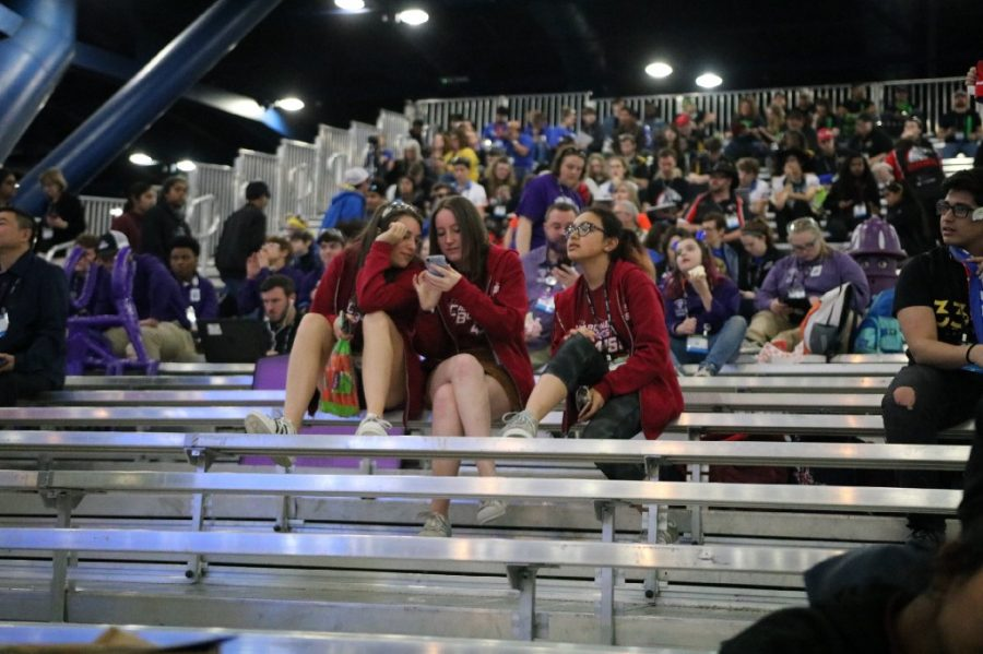 From left to right: Juniors Maya Terplan, Erne Mccabe and Elizabeth Karas anticipate the results of the FIRST Robotics Championship in Houston, Texas.