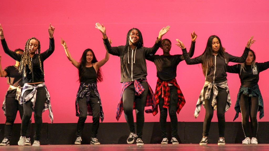Junior Mina Arnold (center) and the rest of BSU performing a dance on May 25 at Multicultural Night in the Carol ChanningTheater.