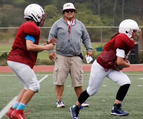 Head coach Danny Chan observes his players during practice including juniors Ronald Pollick and Young Cho.