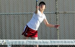 Sophomore Christine Shen concentrates on her overhead shot against the Balboa Buccaneers on Oct. 10.