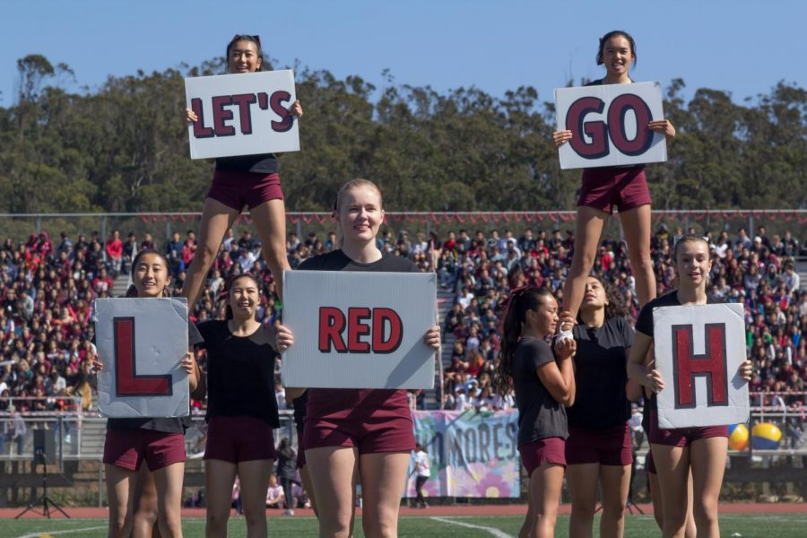 Lowells cheer squad hypes up the crowd.