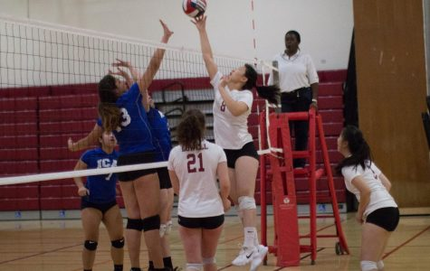 Senior middle blocker Betsy Li attentively blocked an net shot from the ICA Spartans on Oct. 12 at home.