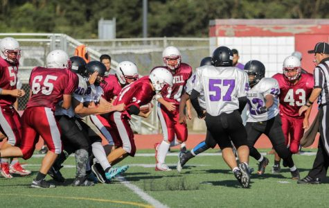Sophomore wingback Justin Yee wrestles his way through defenders for a first down against the Galileo Lions on Oct. 5.