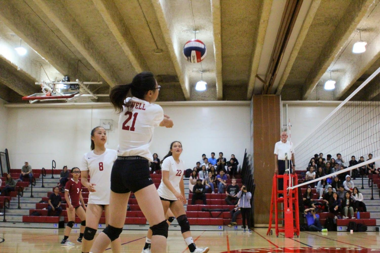 Freshman Heather Liu bumps the ball back over the net on Sept. 14 against the Washington Eagles in the annual Battle of the Birds volleyball game.