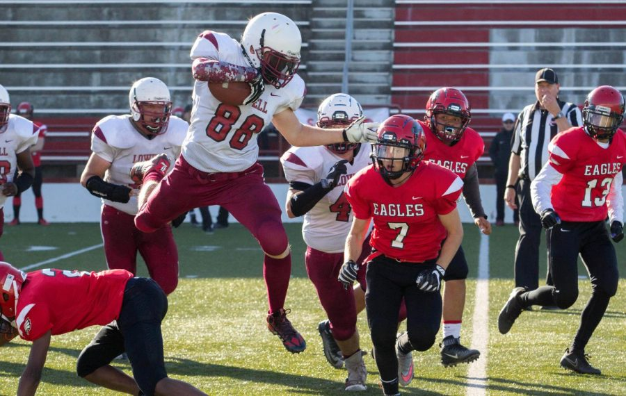 Senior running back Treyvor Turmon jumps over an Eagle defender.