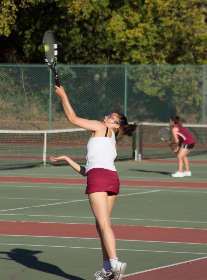 Senior+Julianna+Eng+hits+an+overhead+shot+at+the+AAA+Girls+Tennis+Championship+on+Nov.+2+at+Golden+Gate+Park.