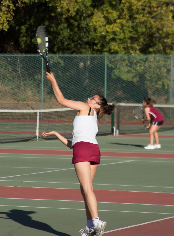 Senior Julianna Eng hits an overhead shot at the AAA Girls Tennis Championship on Nov. 2 at Golden Gate Park.