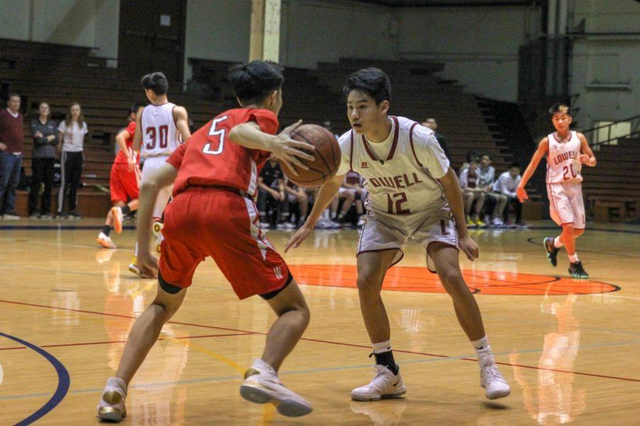 Sophomore forward Derek Quach guards a Washington Eagle.