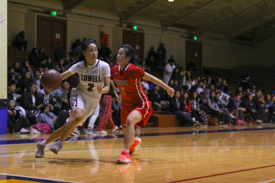 Senior guard KD Lee drives to the basket trying to avoid an Eagle defender.