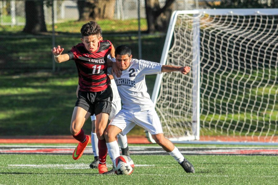 Sophomore striker Alejandro Palos fights for the ball with a OConnell defender