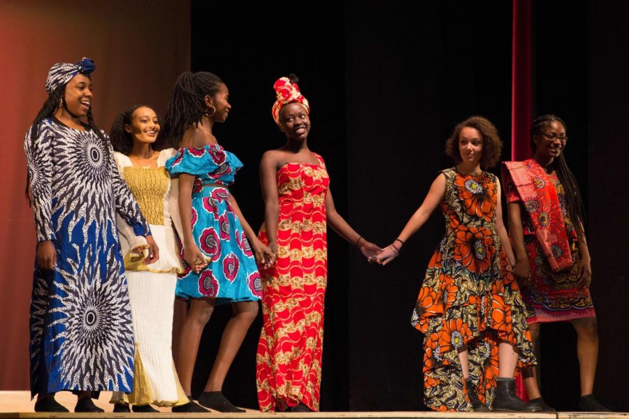 BSU members walk in the Black History Month Assembly fashion show