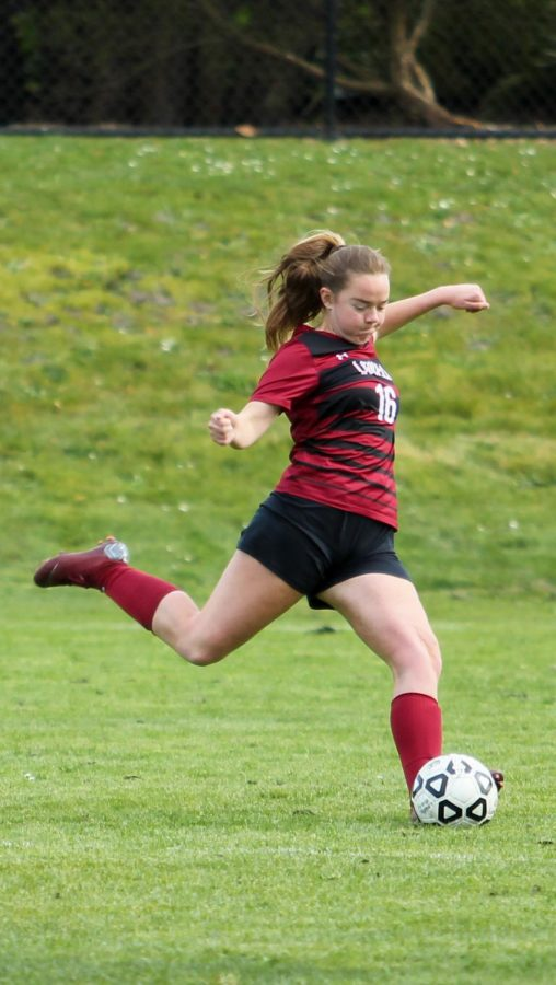 Senior co-captain and defender Fiona Plunkett kicks the ball out of Lowells side of the field.