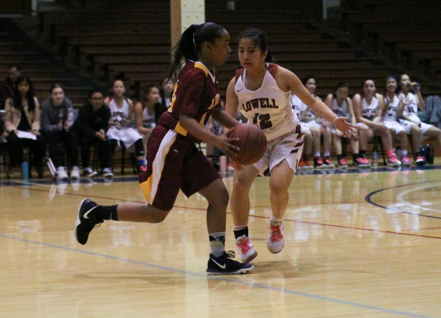 Sophomore guard Jaelyn Braganza blocks a Lincoln Mustang from advancing down the court during the annual AAA championship on Feb. 15 at Kezar Stadium.