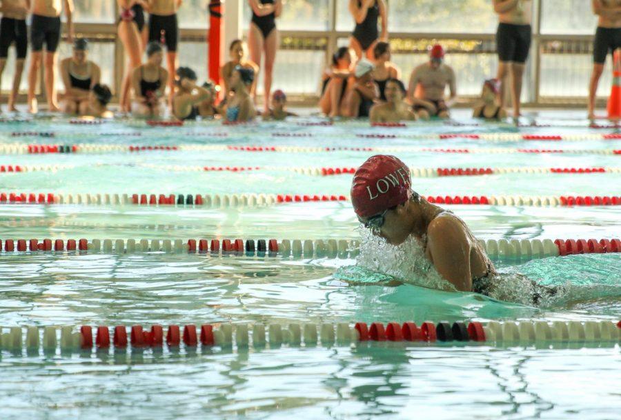 Junior varsity swimmer Maddie Chew swims the breaststoke.