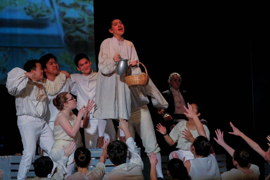 Junior Elisa Jeffries, as Tobias Ragg, attempts to serve the crowds demand for meat pies.