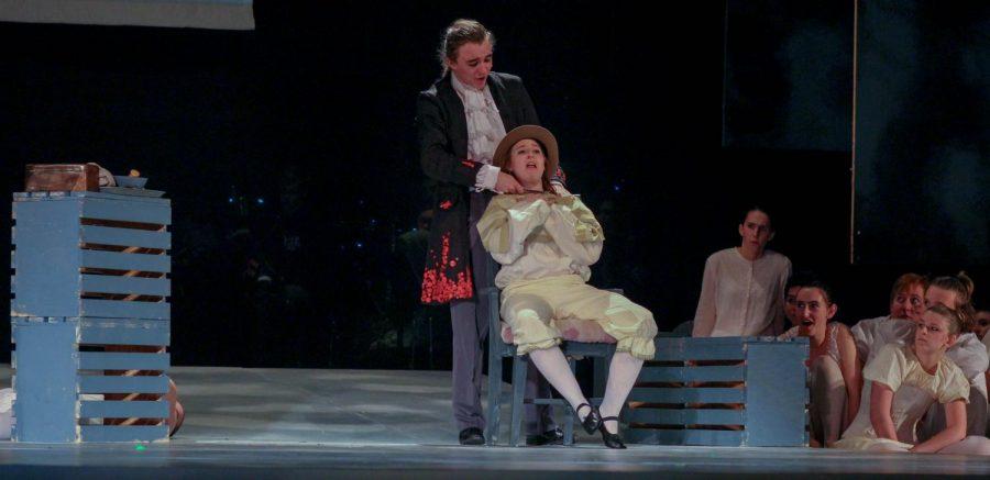 Junior Ariel Anderson, as Sweeney Todd, kills senior Kaya Brown, as a customer, while singing of his daughter Johanna.