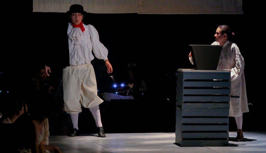 Junior Elisa Jeffries, as Tobias Ragg, is locked into the bake house with the corpse of junior Alexander Ruiz, as The Beadle.