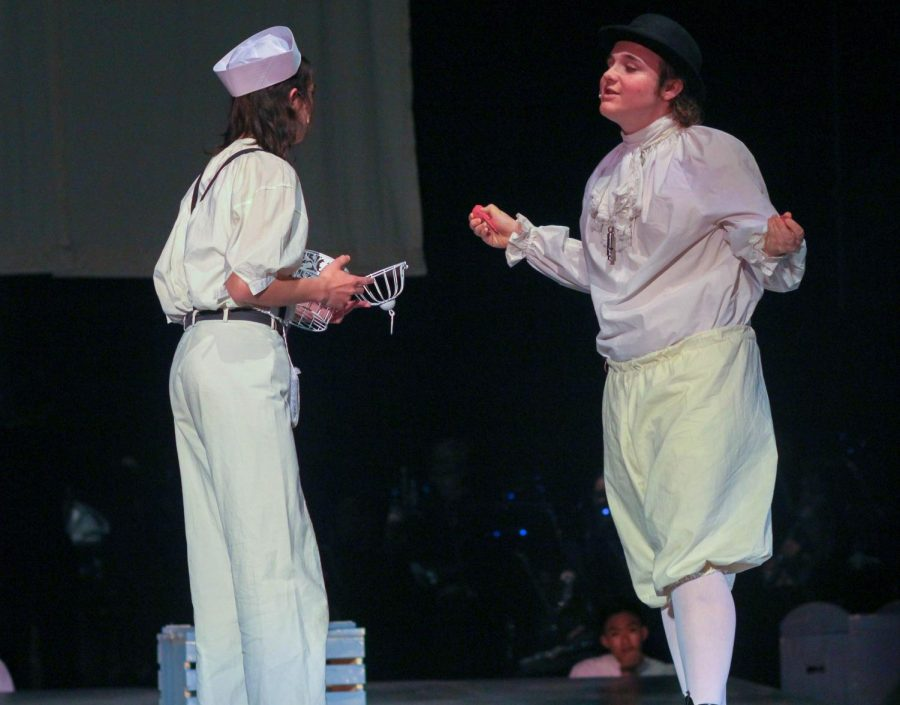 Senior Andrew Green, as  The Beadle, decapitates the bird sophomore Marlo Perez,  as Anthony, bought for Johanna.
