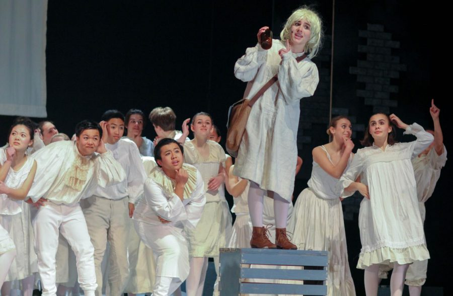 Junior Isabelle Trillin-Lee, as Tobias Ragg, advertises Pirelli's Miracle Elixir to an interested crowd.
