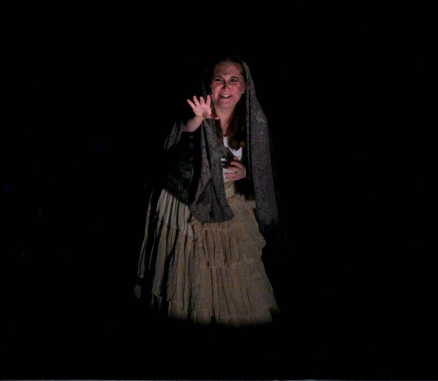 Senior Hailey Mogul, as the Beggar Woman, warns of lurking evil.