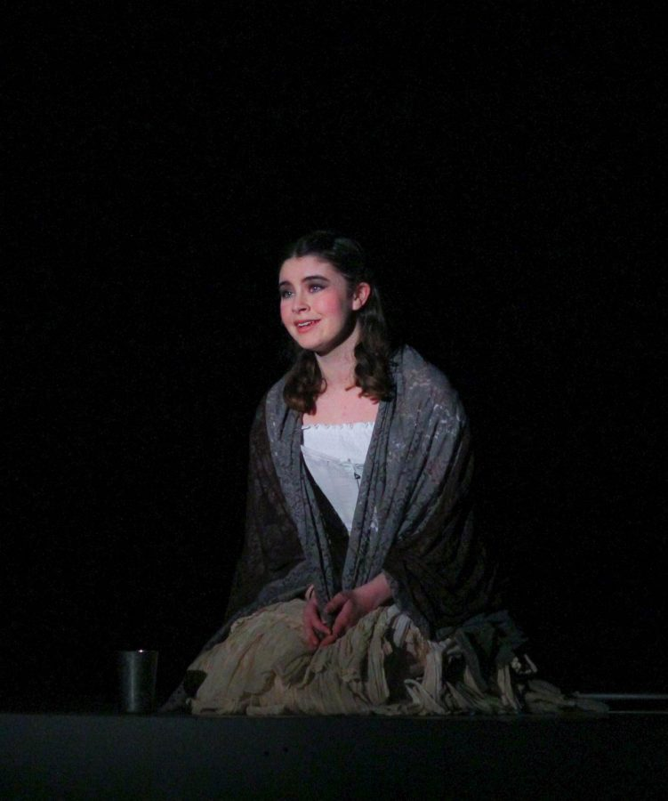 Junior Emma Greene opens the show as the Beggar Woman.
