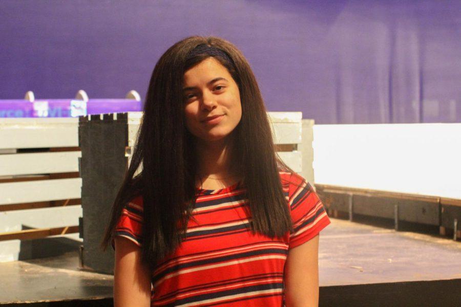Emily Ferguson, a bird seller in the upcoming Spring Musical
