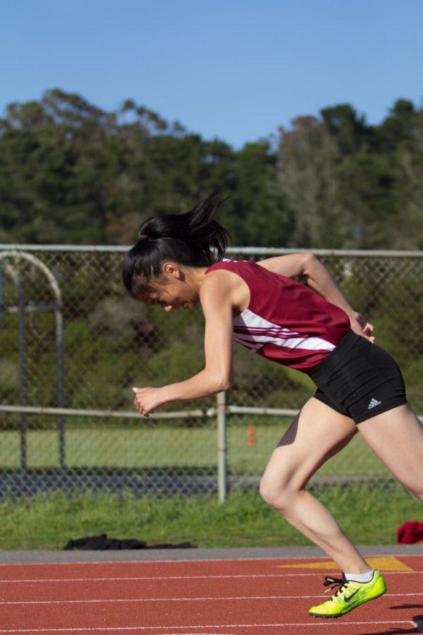 Senior sprinter Emily Liu comes off the starting block in the 200m.