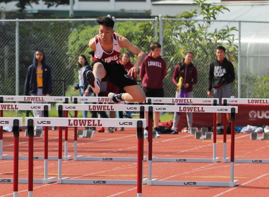 Sophomore sprinter Miguel Santos leaps over a hurdle in the 110m intermediate hurdles.