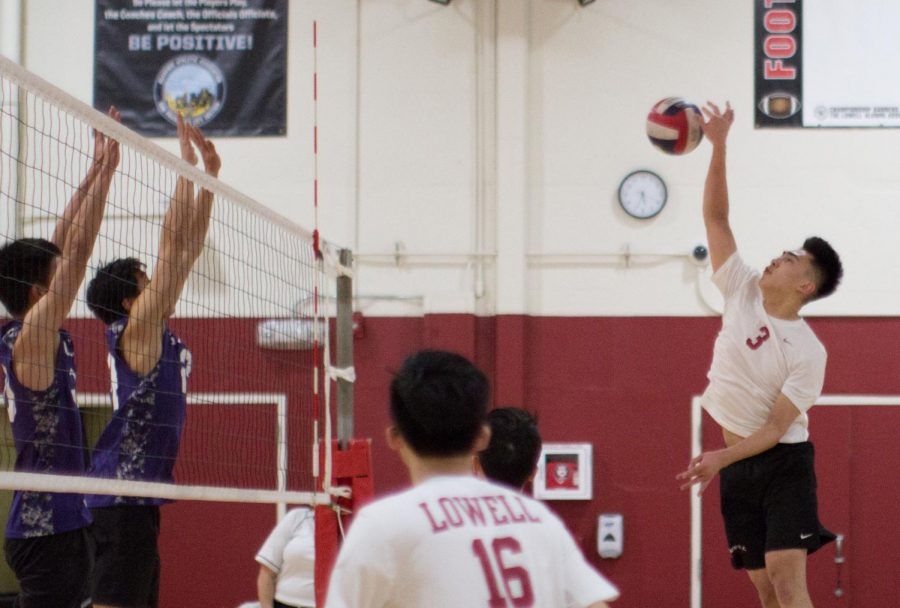 Junior right side hitter George Pan confronts the Galileo Lions with a furious spike on Mar. 20 at home.