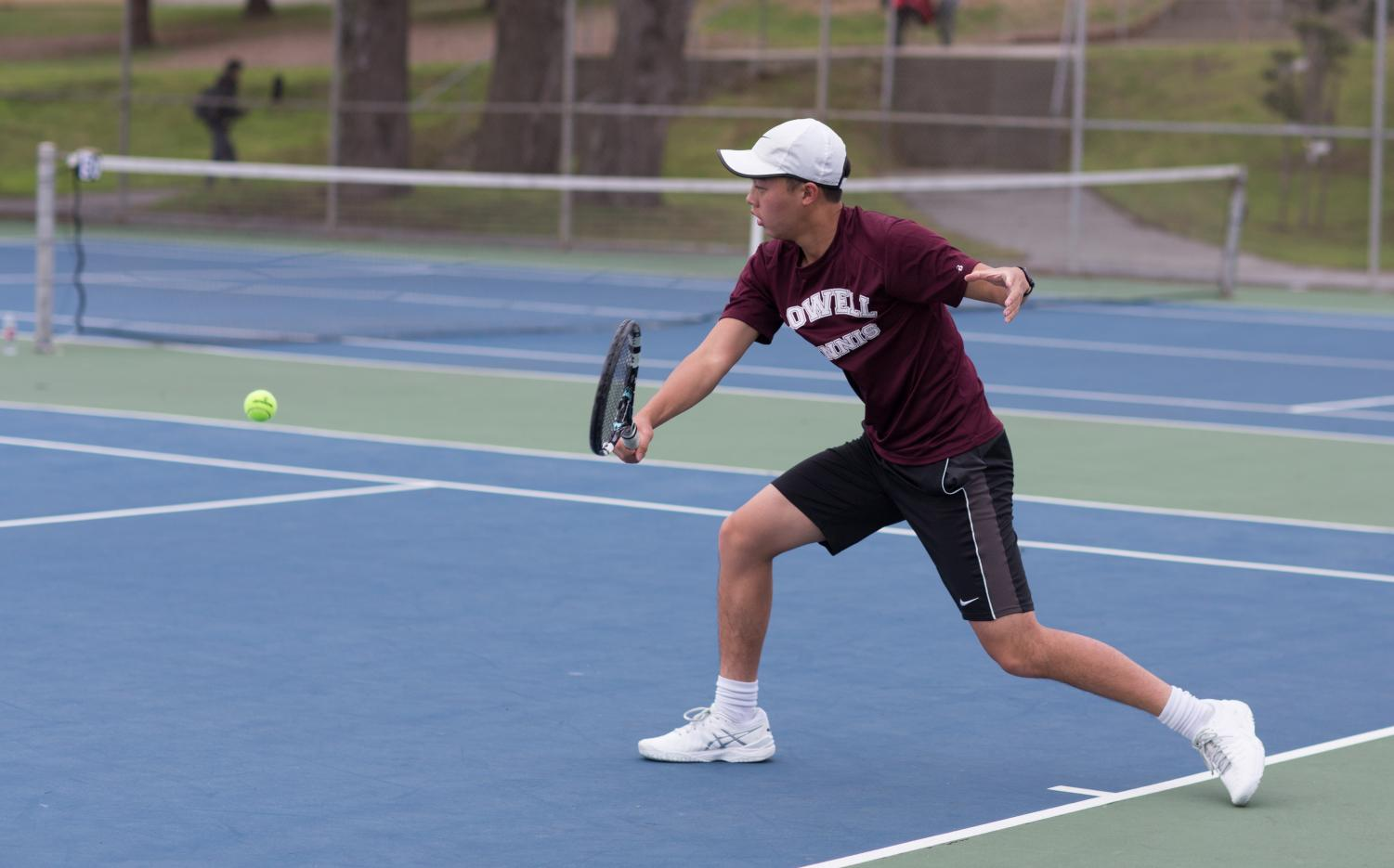 Senior Andrew Trinh, who won his doubles matches against the Archbishop Riordan Crusaders on April 5 at home, performs a backhand shot.
