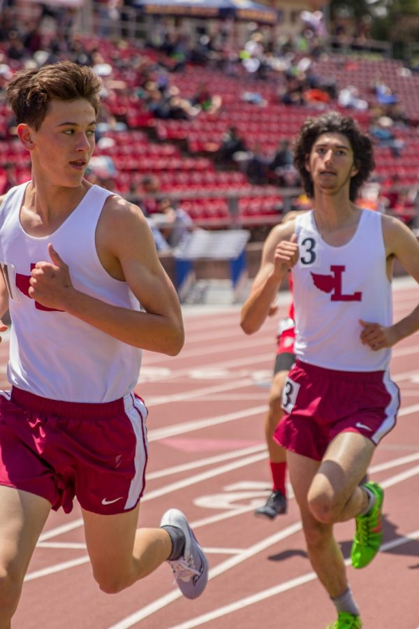 Sophomore Andrew Blelloch looks back at freshman Paolo Canigiula in the frosh-soph boys 1600m run. Canigiula ended up beating Blelloch by four seconds.