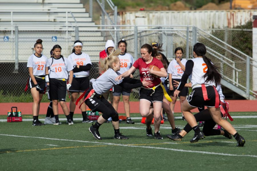 Sophomore Madalynn Schmitt pushes through a few Balboa defenders during a playoff game against the Balboa Bucanneers.