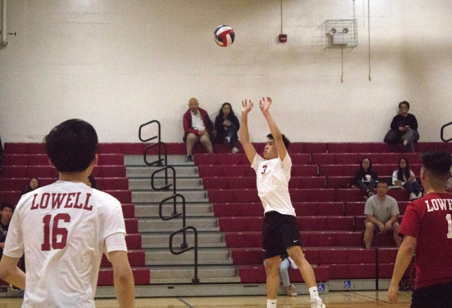 As his teammates attentively watch, junior right side hitter George Pan leaps for a hit against the Washington Eagles on April 10  at home.