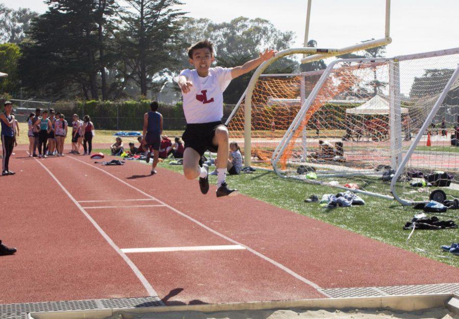 Freshman Benjamin Yee in the long jump for the frosh-soph boys division.
