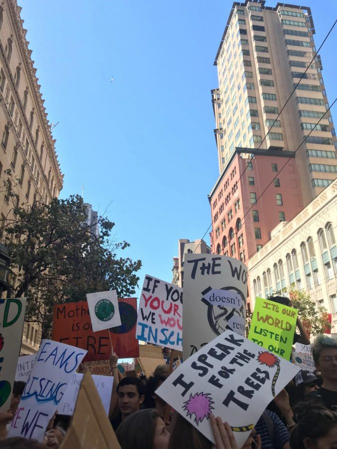 Students gathered around the San Francisco Federal Building with their signs at the start of the march.