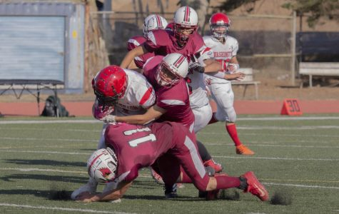Lowell defense tackles the opponent. Photo by Nico Ramirez.