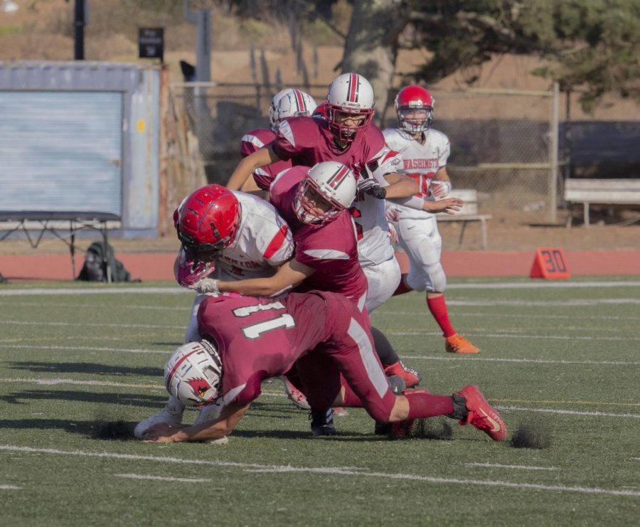 Lowell+defense+tackles+the+opponent.+Photo+by+Nico+Ramirez.