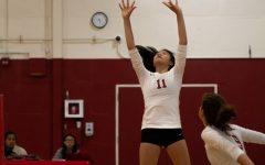 Anita Liu Lowell junior Gabriella Quach sets the ball to Lowell senior Pearl Vermilyea.
