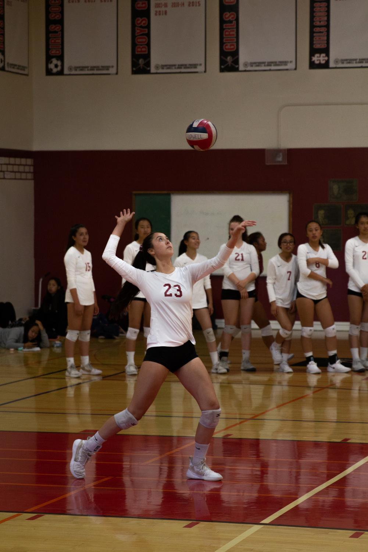 Mariko Tanaka sets up a serve towards the opposing Lincoln side. Photo by Anita Liu