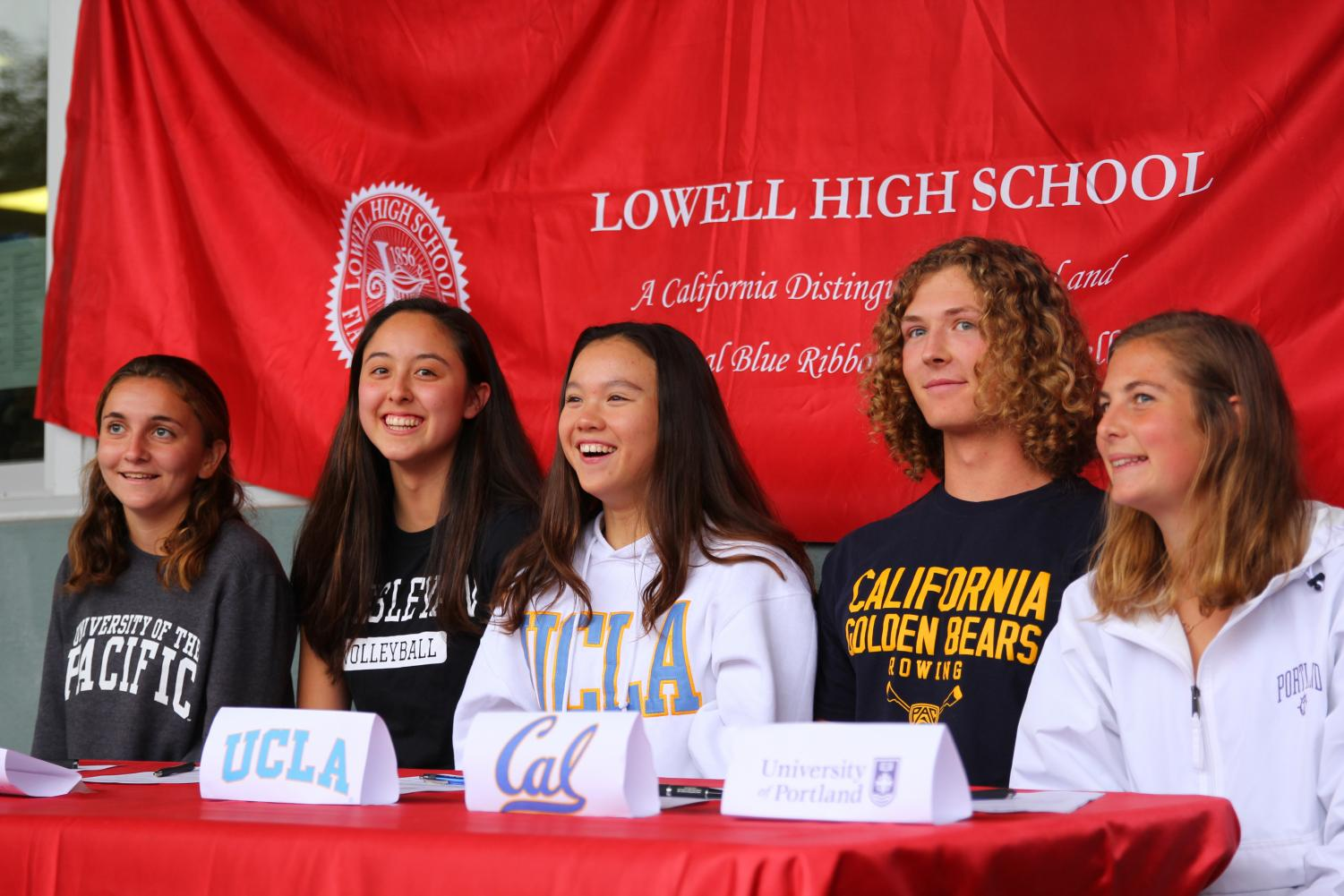 Seniors (from left to right) Audrey Fuchs, Mariko Tanaka, Crystal Murphy, Curtis Bottomley, and Hannah McCord being honored at Lowell's first-ever NCAA signing ceremony.