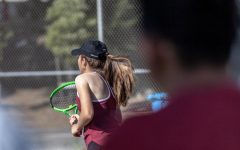 Sophomore Danielle Vakutin is pictured setting up for their opponents serve. Photo by Nico Ramirez.