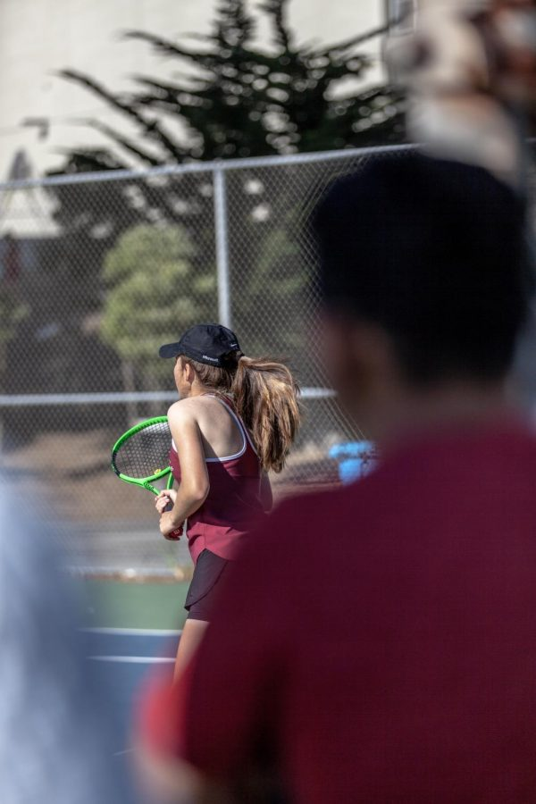 Sophomore+Danielle+Vakutin+is+pictured+setting+up+for+their+opponents+serve.+Photo+by+Nico+Ramirez.